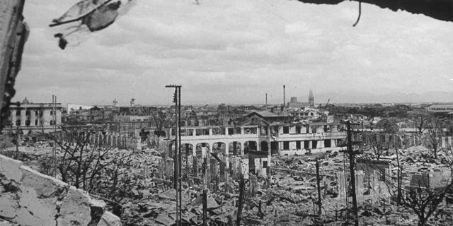 PHILIPPINES - MARCH 1945: Ruins of bombed-out buildings as seen from remains of City Hall, part of the resulting destruction caused by the battles to take back the city from occupying Japanese forces.