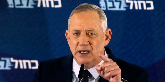 FILE - In this Saturday, March 7, 2020 file photo, Blue and White party leader Benny Gantz delivers a statement in Tel Aviv, Israel. (AP Photo/Sebastian Scheiner, File)