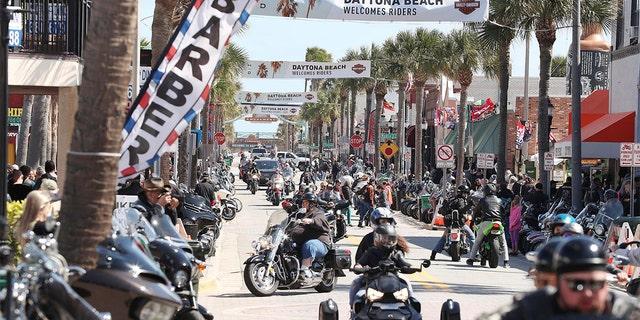 Bikers fill Main Street during Bike Week in Daytona Beach on Saturday, March 7, 2020. (Stephen M. Dowell/Orlando Sentinel via AP)