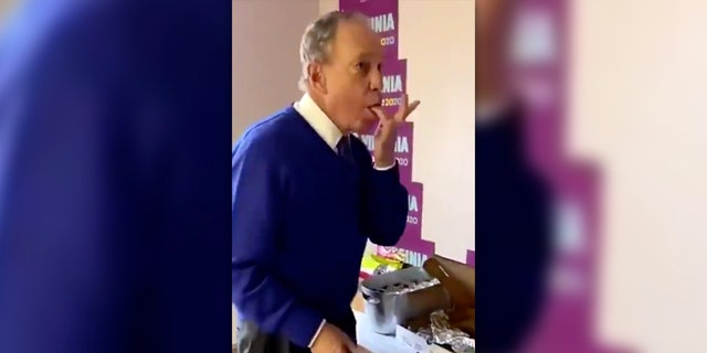 Mike Bloomberg was roasted on social media on Tuesday after a viral video showed him aggressively licking his fingers while eating part of a communal pizza.