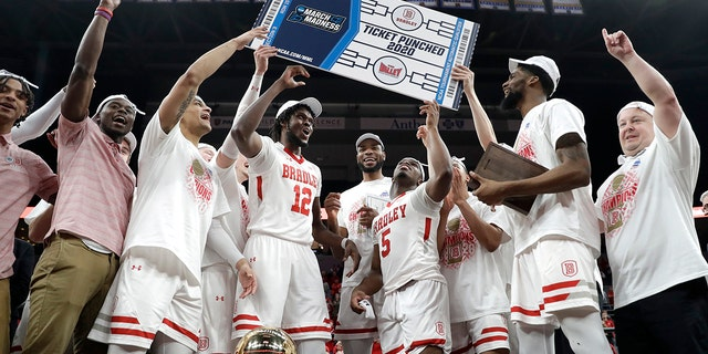 Members of Bradley celebrate after defeating Valparaiso 80-66 during an NCAA college basketball game in the championship of the Missouri Valley Conference men's tournament Sunday, March 8, 2020, in St. Louis. (AP Photo/Jeff Roberson)