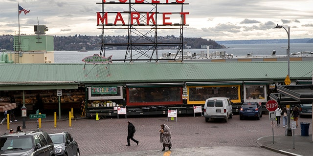 SEATTLE, WASHINGTON - MARCH 10: The Pike Place Market stands virtually empty of patrons on March 10, 2020 in downtown Seattle, Washington. The historic farmer's market is Seattle's most popular tourist attraction, and business has been especially hard hit by coronavirus fears. (Photo by John Moore/Getty Images)