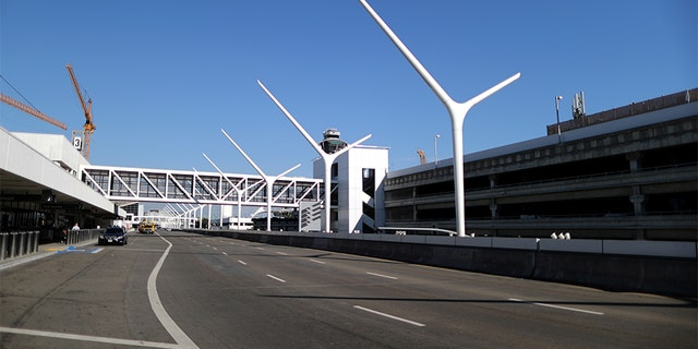 An empty road that runs past terminals is seen at LAX airport in Los Angeles, Calif., amid reports of the coronavirus, March 11, 2020. (REUTERS/Lucy Nicholson)