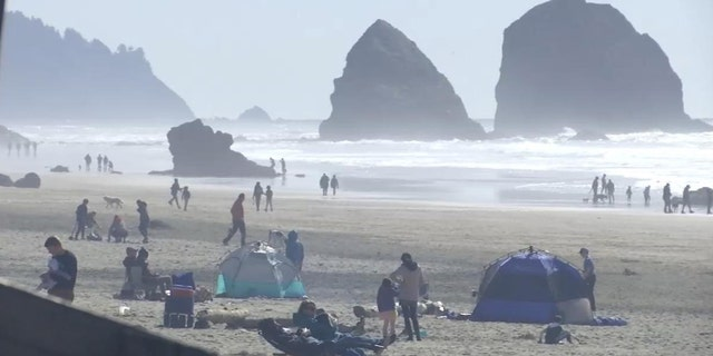 Oregon communities have enacted restrictions after visitors swarmed areas on Friday as authorities have promoted social distancing to combat the spread of the coronavirus.