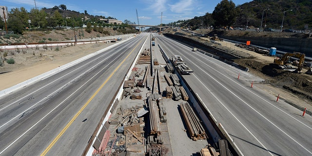 LOS ANGELES, CA - SEPTEMBER 29: All lanes of the 405 Freeway are empty except for construction trucks as crews continue to demolish a portion of the Mulholland Drive bridge along the 405 Freeway September 29, 2012 in Los Angeles, California.
