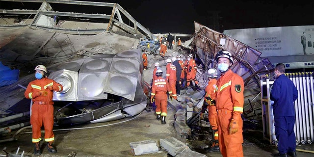Rescuers work at the site of a collapsed five-story hotel building in Quanzhou city in southeast China's Fujian province Saturday, March 7, 2020.