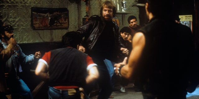 Chuck Norris fighting against a group of men in the film 'Code of Silence.'
