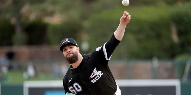 Chicago White Sox pitcher Dallas Keuchel throws during the second inning of a spring training baseball game against the San Diego Padres Monday, March 2, 2020, in Glendale, Ariz. (AP Photo/Matt York)