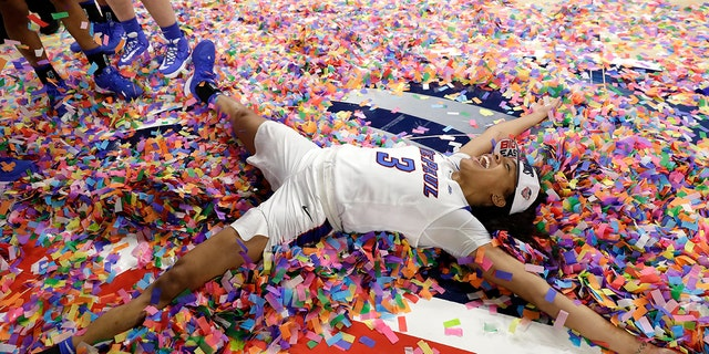 DePaul's Deja Church celebrates with teammates after they defeated Marquette in an NCAA college basketball game in the Big East women's tournament final, Monday, March 9, 2020, in Chicago. (AP Photo/Nam Y. Huh)