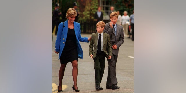 Prince William arrives with Diana, Princess of Wales and Prince Harry for his first day at Eton College on September 16, 1995 in Windsor, England