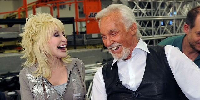 Singers/songwriters Dolly Parton and Honoree Kenny Rogers Backstage at the Kenny Rogers: The First 50 Years show at the MGM Grand at Foxwoods on April 10, 2010, in Ledyard Center, Connecticut.