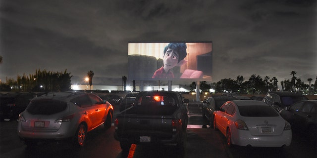 "Viewers in parked cars watch the animated film ""Onward"" at the Paramount Drive-In Theatres, Thursday, March 19, 2020, in Paramount, Calif. The drive-in theater, long a dwindling nostalgia act in a multiplex world, is experiencing a momentary return to prominence. With nearly all of the nation's movie theaters shuttered due to the pandemic, some drive-in owners think they're in a unique position to give moviegoers a chance to do something out of the house but stay within prudent distance from one another. (AP Photo/Chris Pizzello)"
