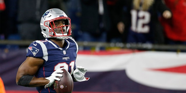 New England Patriots safety Duron Harmon (21) reacts after making an interception during the fourth quarter against the Minnesota Vikings at Gillette Stadium.