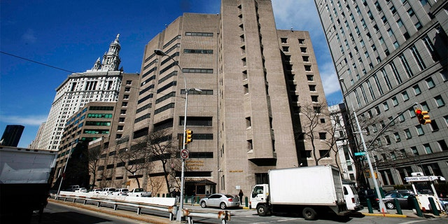 The Justice Department has opened a criminal investigation into potential misconduct by guards as officials keep inmates locked down at the federal jail in New York where financier Jeffrey Epstein killed himself over the summer, three people familiar with the matter told The Associated Press on Thursday. (AP Photo/Mark Lennihan, File)