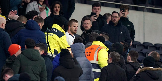 In this Wednesday, March 4, 2020 photo, Tottenham Hotspur's Eric Dier, center, reacts in the stands, following the FA Cup fifth round soccer match between Tottenham Hotspur and Norwich, at Tottenham Hotspur Stadium, London.