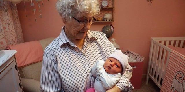 Geneva Wood and one of her great-grandchildren June Neidigh.