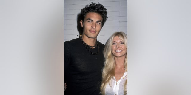 Jason Momoa and model Brande Roderick attend Miramax Party in Honor of Henry Diltz on November 30, 2000, in Los Angeles, California.