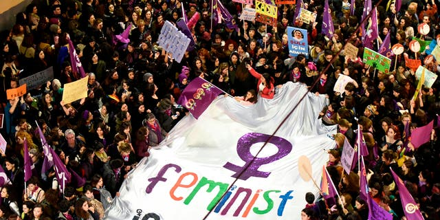 Demonstrators hold a banner and placards during a rally marking the International Women's Day on Istiklal avenue, in Istanbul, on March 8, 2019.