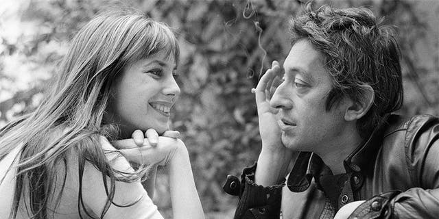 Jane Birkin and Serge Gainsbourg pictured together at home in Paris, France, circa 1972.