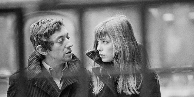 French singer and songwriter Serge Gainsbourg and his partner, British singer and actress Jane Birkin, in the courtyard of the French National College of Fine Arts, in Paris.