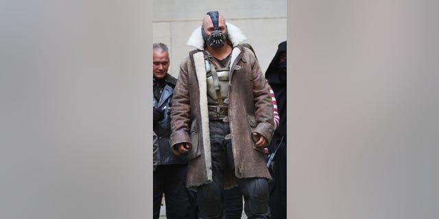 Tom Hardy is seen in costume as Bane on the set of 'The Dark Knight Rises' on location on Wall Street on November 5, 2011 in New York City.
