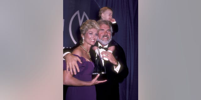 Musician Kenny Rogers, wife Marianne Gordon, and son Christopher Rogers attend the 10th Annual American Music Awards on January 17, 1983, at Shrine Auditorium in Los Angeles, California. (Photo by Ron Galella/Ron Galella Collection via Getty Images)