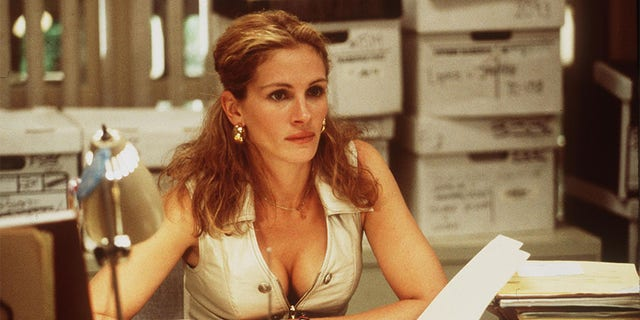 Erin Brockovich recalled her comical first encounter with Julia Roberts (pictured).