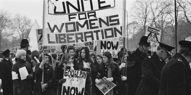 Members of the National Women's Liberation Movement participate in an equal-rights march in London to mark International Women's Day in March 1971.
