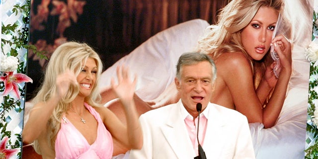 Playmate Of The Year, Brande Roderick cheers as Hugh Hefner makes a speech at the Playmate Of The Year Party April 26, 2001, in Los Angeles, CA.