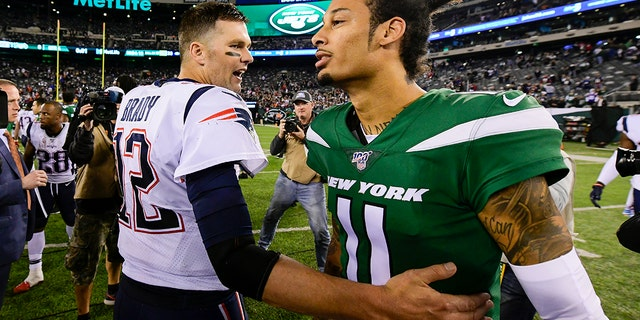 Tom Brady #12 of the New England Patriots shakes hands with Robby Anderson #11 of the New York Jets after his 33-0 win at MetLife Stadium on October 21, 2019 in East Rutherford, New Jersey. (Photo by Steven Ryan/Getty Images)