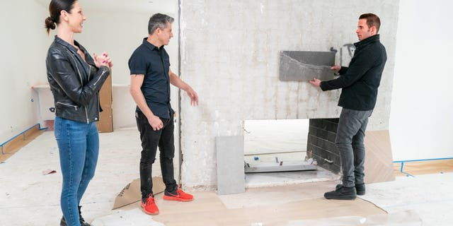 As seen on HGTV's 'Flipping 101,' host Tarek El Moussa, checks the progress on a house owned by first time home flippers Patricia (L) and Legacy (Center), as he mentors them through the home flipping process.