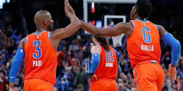 Oklahoma City Thunder guard Chris Paul (3) and Oklahoma City Thunder guard Hamidou Diallo (6) high-five during the second half against the San Antonio Spurs at Chesapeake Energy Arena. (Alonzo Adams-USA TODAY Sports)