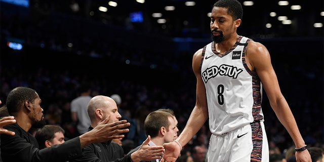 Spencer Dinwiddie of the Brooklyn Nets high-fives coaches after coming out of the game during the first half against the Miami Heat at Barclays Center on January 10, 2020 in the Brooklyn borough of New York City. (Sarah Stier/Getty Images)