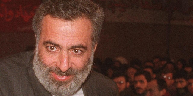 Iranian ambassador to Syria Hossein Sheikholeslam (L) with Hamas political bureau chief Khaled Meshaal (R) at a gathering organized by the Hamas Islamic resistance movement 21 January 2000 at the Yarmouk Palestinian refugee camp near Damascus to commemorate the fourth anniversary of the assassination by Israel of the Hamas engineer Yahia Ayash. (Photo by Louai Beshara / AFP) (Photo by LOUAI BESHARA/AFP via Getty Images)