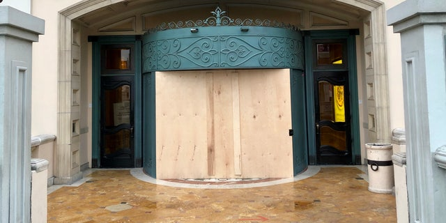 An entrance to the Bellagio is boarded up.