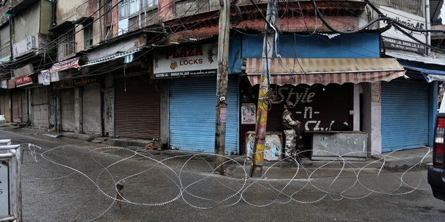 A barbed wire erected by authorities as part of enforcing a lockdown as a precautionary measure against COVID-19 in Jammu, India, Tuesday.