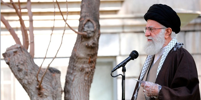 Wearing disposable gloves, Supreme Leader Ayatollah Ali Khamenei speaks during a tree planting ceremony in Tehran, Iran, Tuesday, March 3, 2020. Iran's supreme leader put the Islamic Republic on war footing Tuesday against the new coronavirus by ordering its armed forces to assist health officials in combating the outbreak that authorities say has killed 77 people. (Office of the Iranian Supreme Leader via AP)