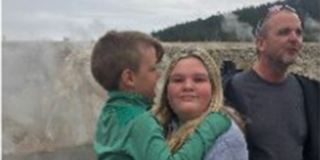 Tylee Ryan, 17, holds her brother JJ Vallow, 7, at Yellowstone National Park on Sept. 8, the last day she was seen. In the background is their uncle and Lori Vallow's brother Alex Cox.