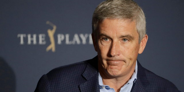 PGA Tour Commissioner Jay Monahan reacts to a question during a news conference at The Players Championship golf tournament, in Ponte Vedra Beach, Fla., early Friday, March 13, 2020. (AP Photo/Chris O'Meara)