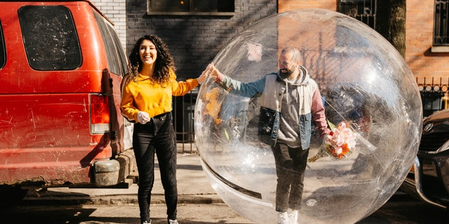 Jeremy Cohen, right, first approached Tori via drone, during self-isolation in their respective Brooklyn residences. Late last week, he donned a bubble so they could hang out in person.