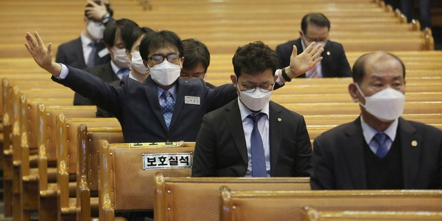 People wearing face masks pray during Mass at the Yoido Full Gospel Church in Seoul, South Korea, Sunday. The church decided to replace Sunday services with online ones for members' safety amid the spread of the COVID-19. (AP Photo/Ahn Young-joon)