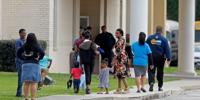 Congregants arrive at the Life Tabernacle Church in Central, La., Sunday, March 29, 2020. Pastor Tony Spell has defied a shelter-in-place order by Louisiana Gov. John Bel Edwards, due to the new coronavirus pandemic, and continues to hold church services with hundreds of congregants. (AP Photo/Gerald Herbert)