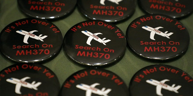 Badges are displayed during the sixth annual remembrance event for the missing Malaysia Airlines flight MH370 in Putrajaya, Malaysia, March 7, 2020.