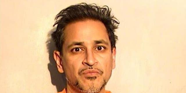 Dr. Manish Gupta, 49, is charged with illegally dispensing controlled substances, aggravated sexual abuse and sex trafficking. (Lucas County Corrections Center)