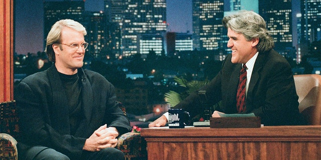 Pictured: (l-r) Musician John Tesh during an interview with host Jay Leno on June 3, 1996.
