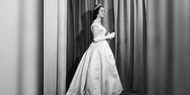 Maria Teresa of Bourbon-Parma wearing a Jacques Heim evening dress.