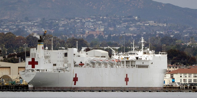 The USNS Mercy, a Navy hospital ship is seen docked at Naval Base San Diego Wednesday, March 18, 2020, in San Diego. Defense Secretary Mark Esper said Tuesday he has asked the Navy to prepare its two hospital ships — the USNS Mercy and the USNS Comfort in New York — for deployment to aid against the coronavirus outbreak. (AP Photo/Gregory Bull)
