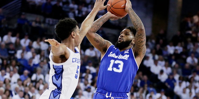 Seton Hall's Myles Powell (13) shoots against Creighton's Ty-Shon Alexander (5) during the first half of an NCAA college basketball game in Omaha, Neb., Saturday, March 7, 2020. (AP)
