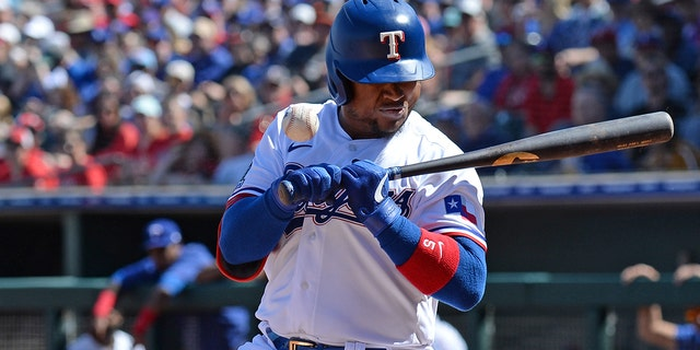 Texas Rangers outfielder Willie Calhoun reacts as he is hit in the face with a pitch during a spring training game in Surprise, Ariz., against the Los Angeles Dodgers. (Joe Camporeale-USA TODAY Sports)