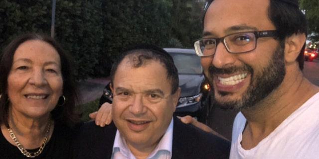 RabbiShlomo Zalman (Sam) Bregman pictured with his religious Jewish parents, saying goodbye until the coronavirus pandemic passes.